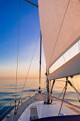Tranquil scene of the sea at sunset onboard a sailboat in the Atlantic ocean. UK Southern coast