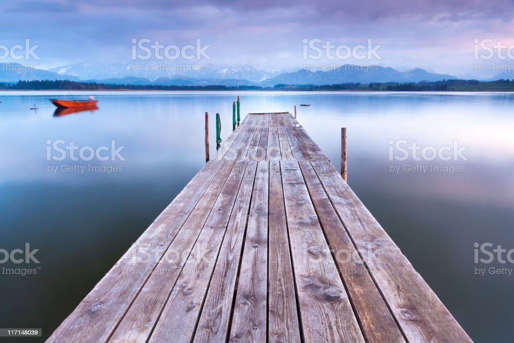 tranquil scene with boat at lake hopfensee stock photo