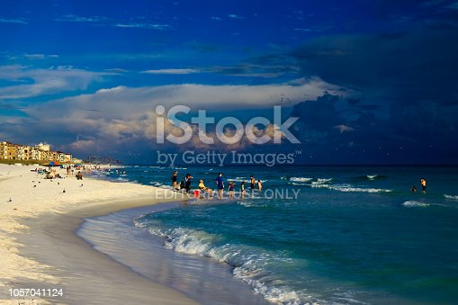 1054156720istockphoto Tranquil sea and thunderclouds in sky at Destin Florida 1057041124
