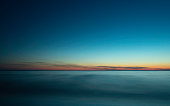 istock Tranquil Seascape over the Soft Misty Waves at Twilight 1207070979