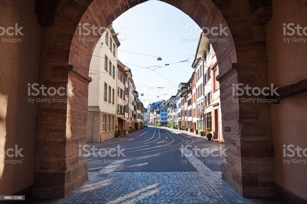 Tranquil street of Basel old city with tram line stock photo
