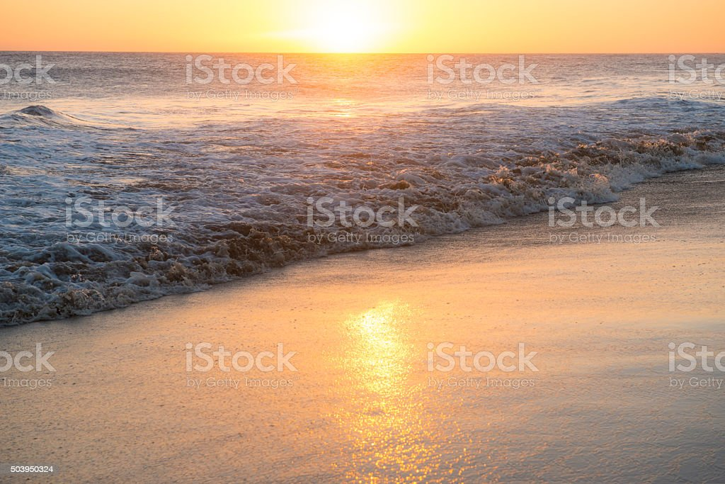 Tranquil sunset at beach royalty-free stock photo