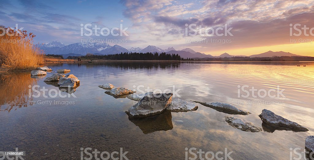 tranquil sunset at lake hopfensee, bavarian alps germany royalty-free stock photo
