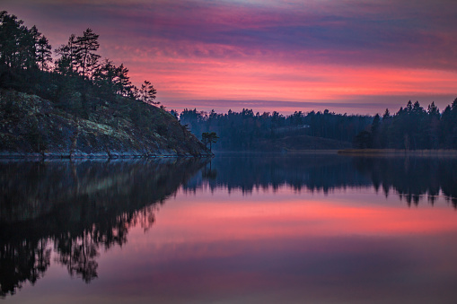 istock Tranquil sunset at lake with reflections 1007441572