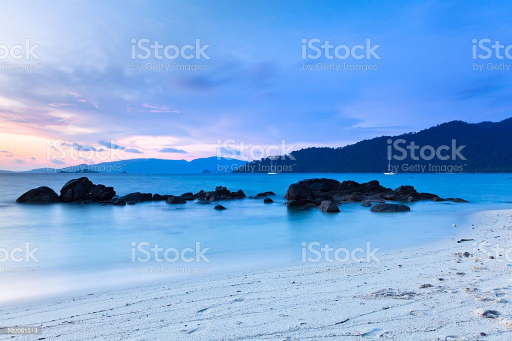 Tranquil sunset scene on the shore of Andaman Sea royalty-free stock photo