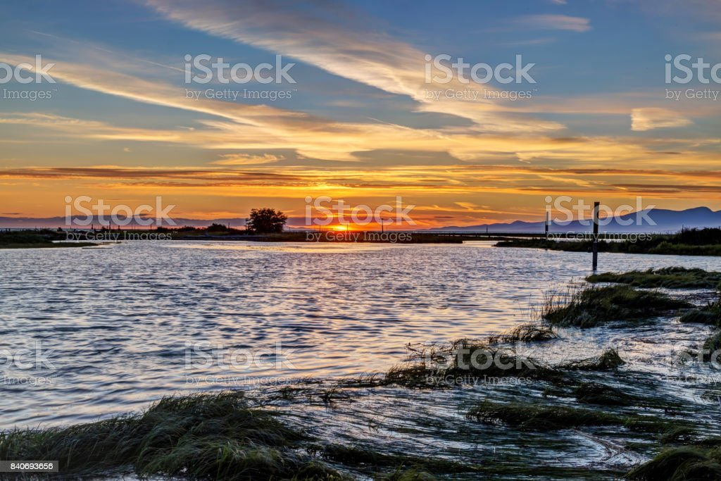 Tranquil sunset view of seaside beach stock photo