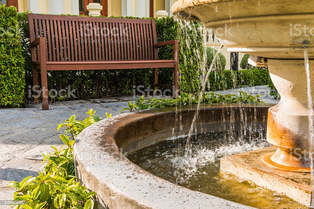 Tranquil with fountain and chairs stock photo