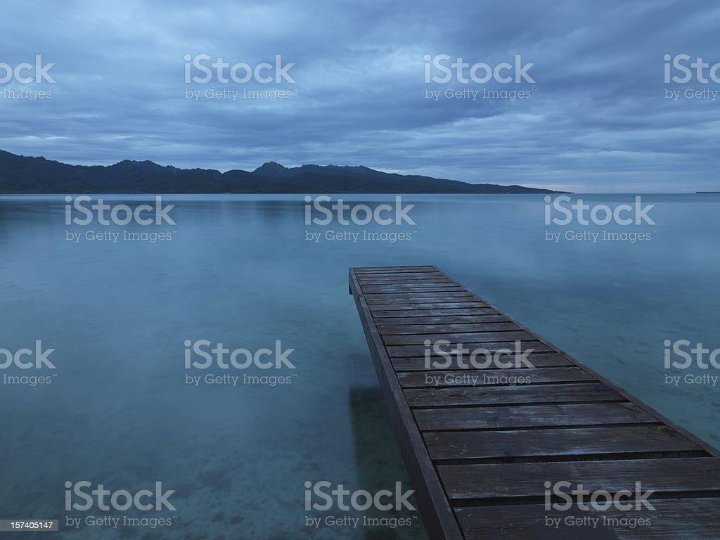 Tranquility. Lonely Pier towards Tahaa Island. stock photo