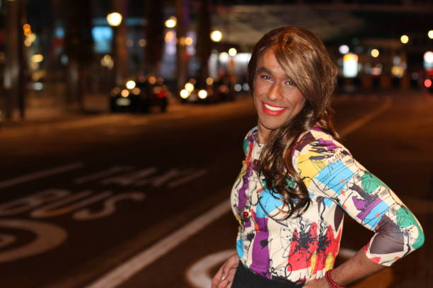 Trans woman outdoors at night with copy space stock photo