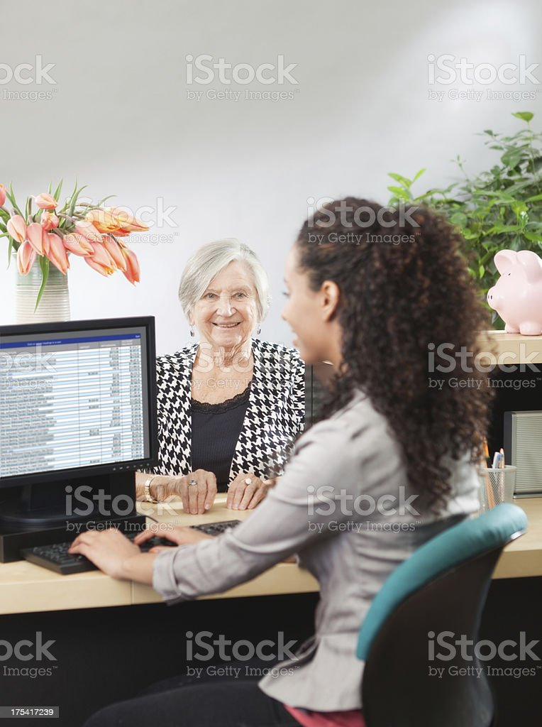 Transaction in Retail Banking Counter Window with Bank Teller Hz royalty-free stock photo