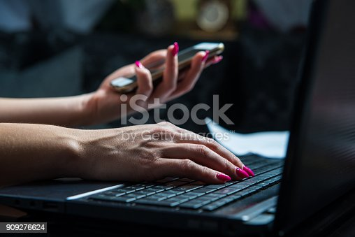 istock Transactions on your mobile phone and laptop. 909276624
