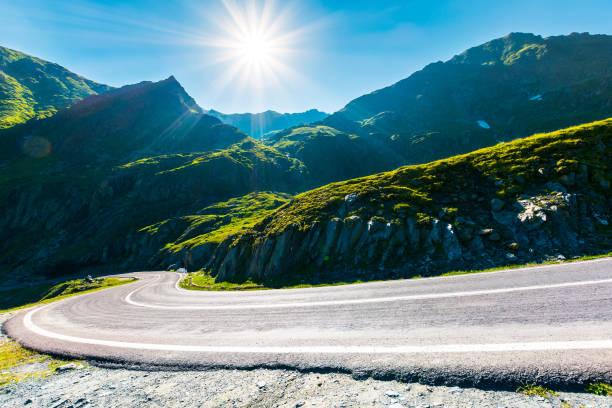 Transfagarasan road in mountains winding uphill stock photo