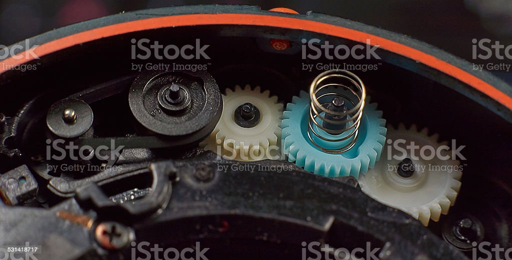 Transfer auto-focus mechanism in the camera lens. stock photo
