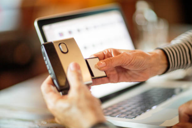 transfer data with memory card reader to a laptop computer - memory card stock photos and pictures