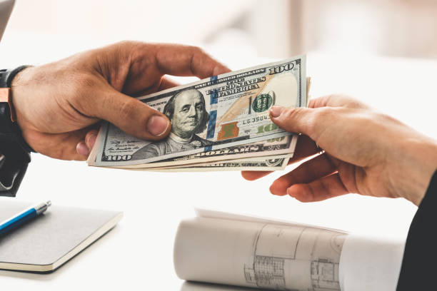 Transfer of money from hand to hand. stock photo