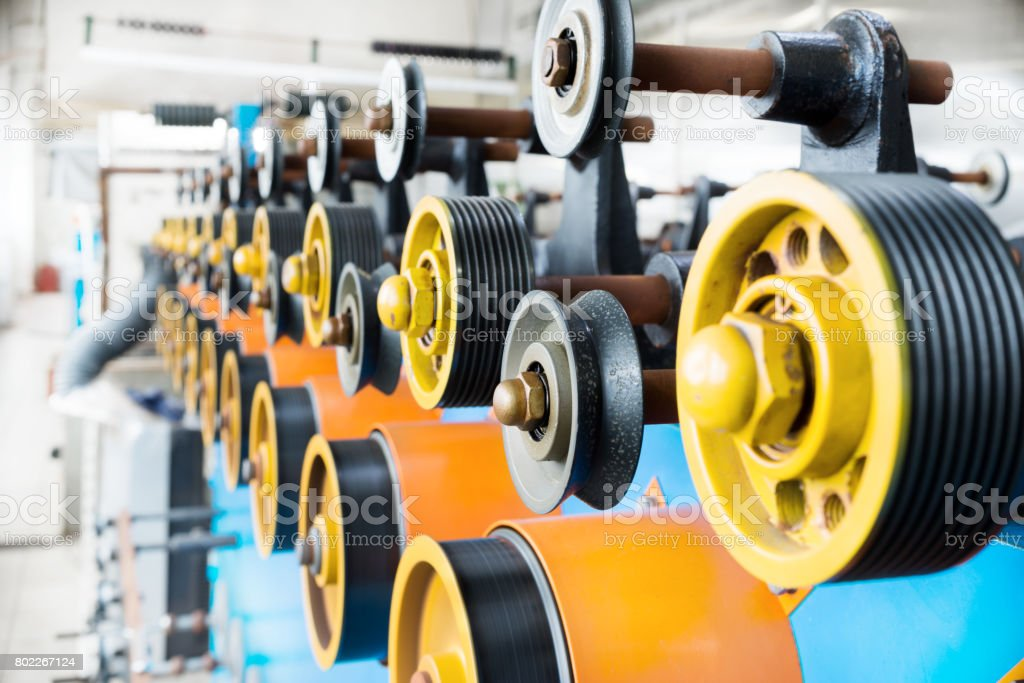 Transfer rubberized rollers of automatic winding machine stock photo