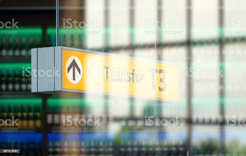 Transfer sign in airport terminal building, in front of bar or taxfree out of focus stock photo