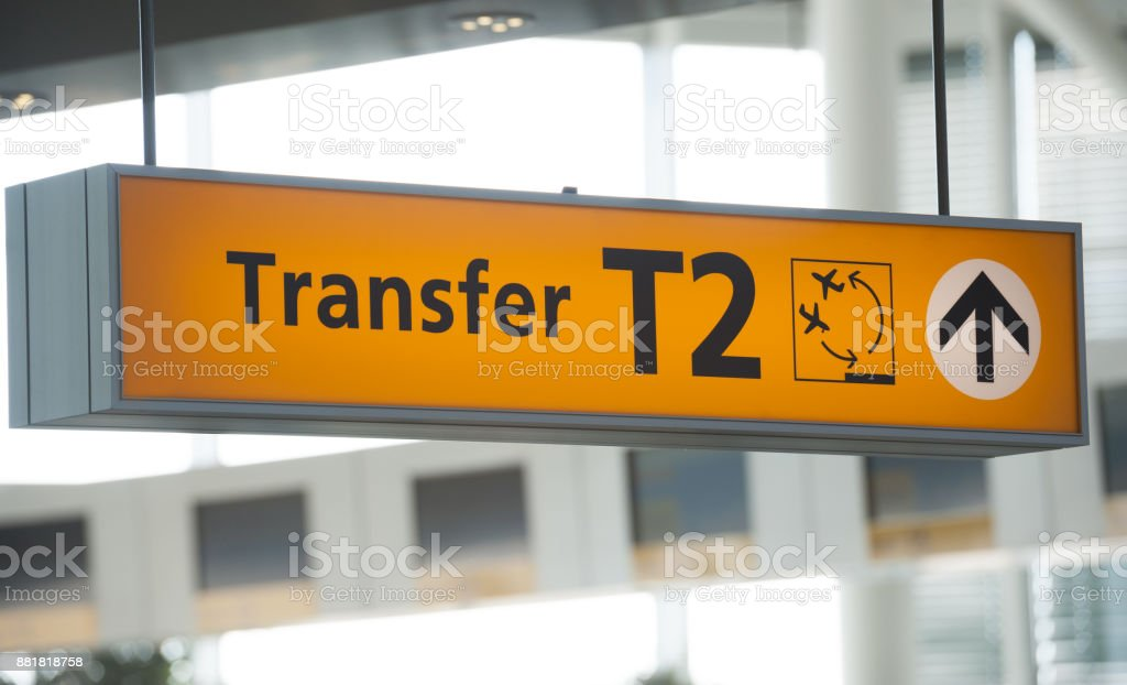 Transfer sign in airport terminal building stock photo