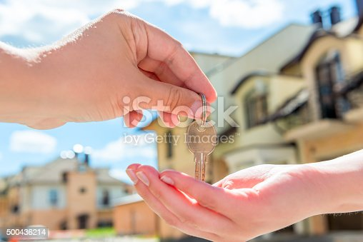 istock transfer to the buyer of the house key  of hands 500436214