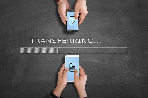 Transferring data from one smartphone to another Transferring data from one smartphone to another illustrated in blackboard transfer image stock pictures, royalty-free photos & images