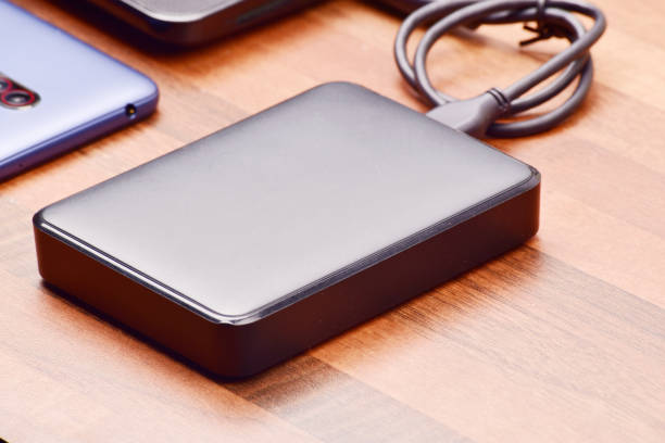 Transferring data to hard disk, external hard disk drive Transferring data to hard disk, external hard disk drive hard disk stock pictures, royalty-free photos & images