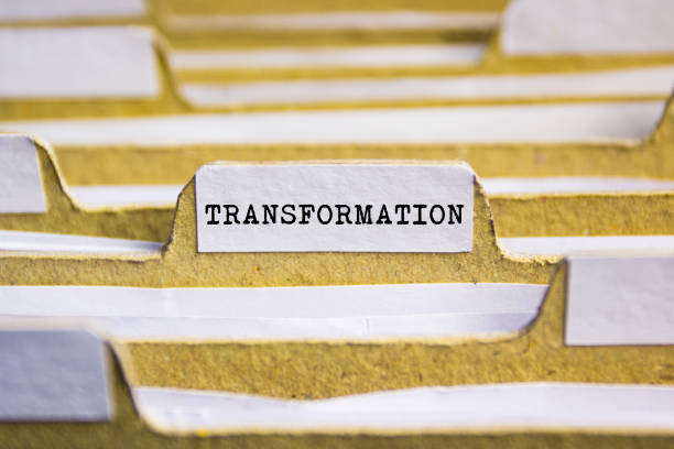 Transformation word on card index paper stock photo