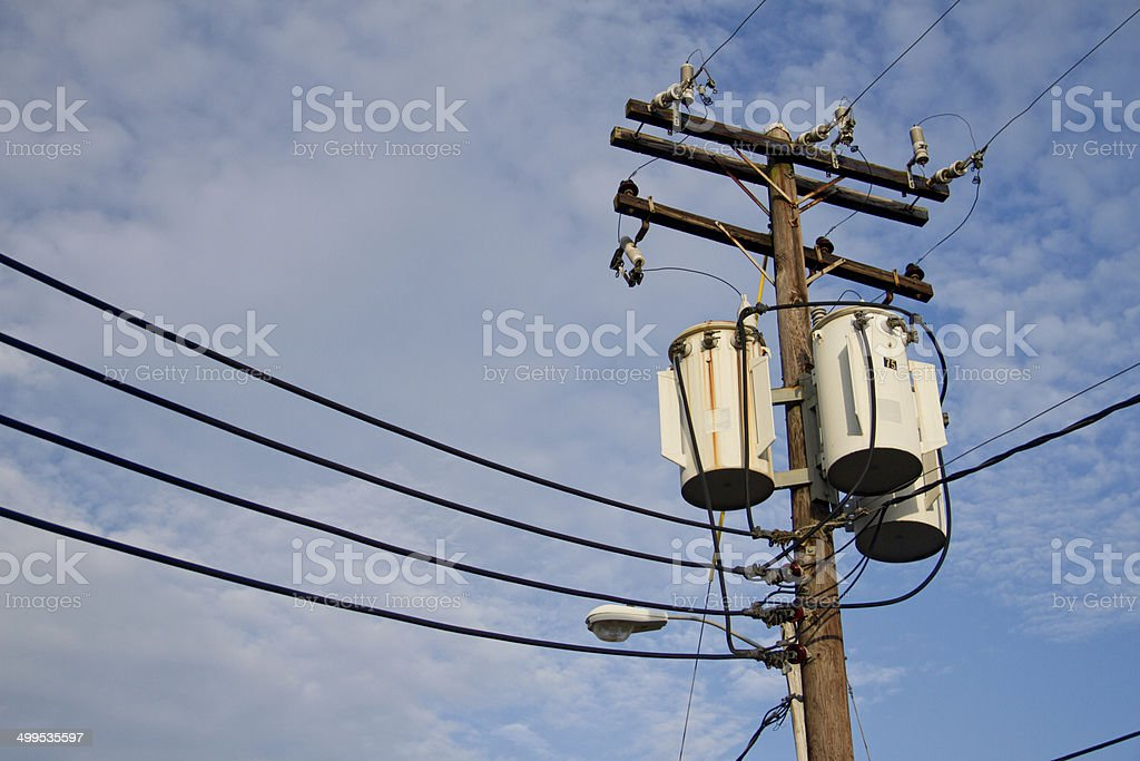 Transformer in a rural area & Old transformer stock photo
