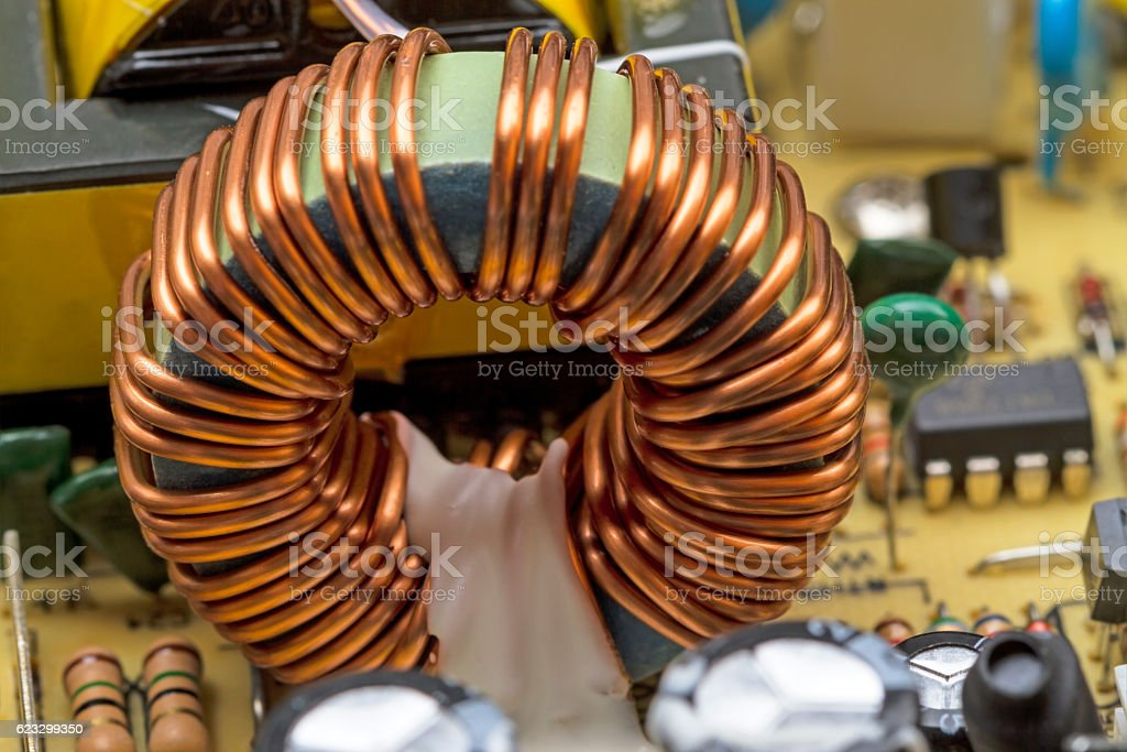 Transformer on a ferrite ring stock photo