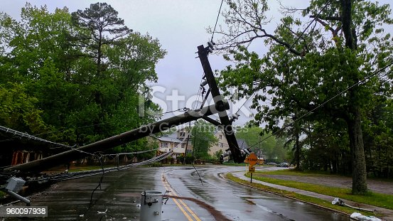 istock transformer on a pole and a tree laying across power lines over a road after Hurricane moved across 960097938