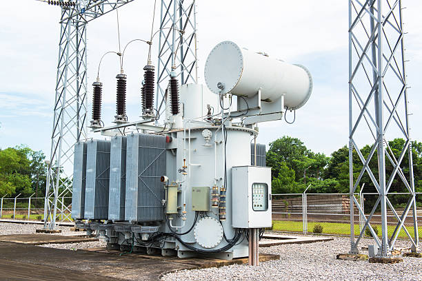 transformer station and the high voltage electric pole - transformers stock photos and pictures