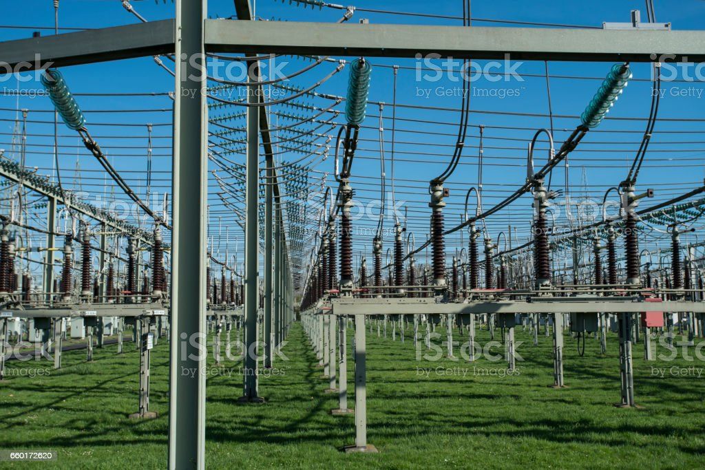 Electrical Transformer station in front of blue sky