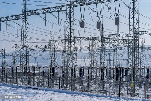 600401714istockphoto Transformer substation in the winter. 1131661748