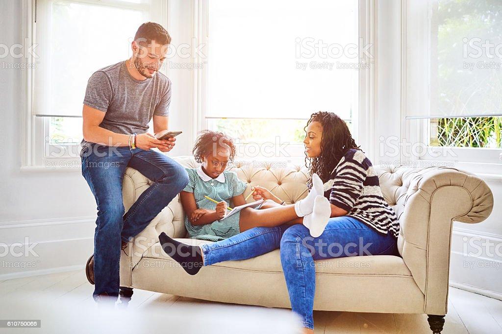 Transgender family sitting on sofa in living room stock photo