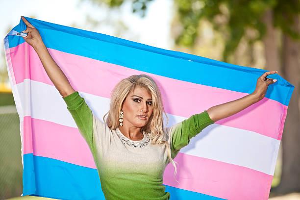 Transgender female holding Pride flag stock photo