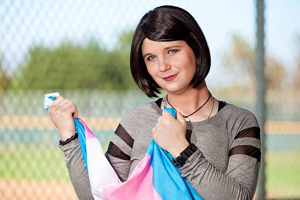 Transgender girl holding Pride flag stock photo