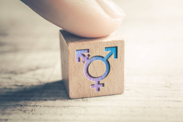 Transgender, LGBT or Intersex Icon On A Wodden Block On A Table Arranged By A Finger Transgender, LGBT or Intersex Icon On Wodden Block On A Table Arranged By A Finger prettige verrassingen stock pictures, royalty-free photos & images