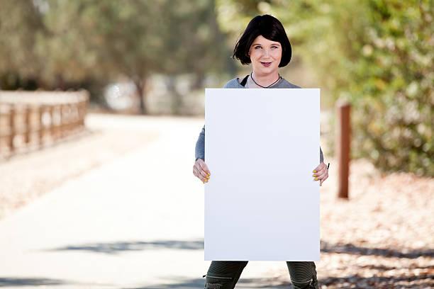 Transgender male to female holding blank sign stock photo