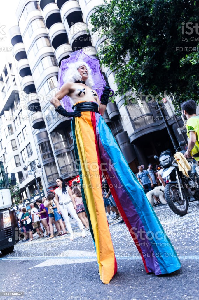 Transgender man in stilts during parade of gay pride at Valencia-Spain stock photo