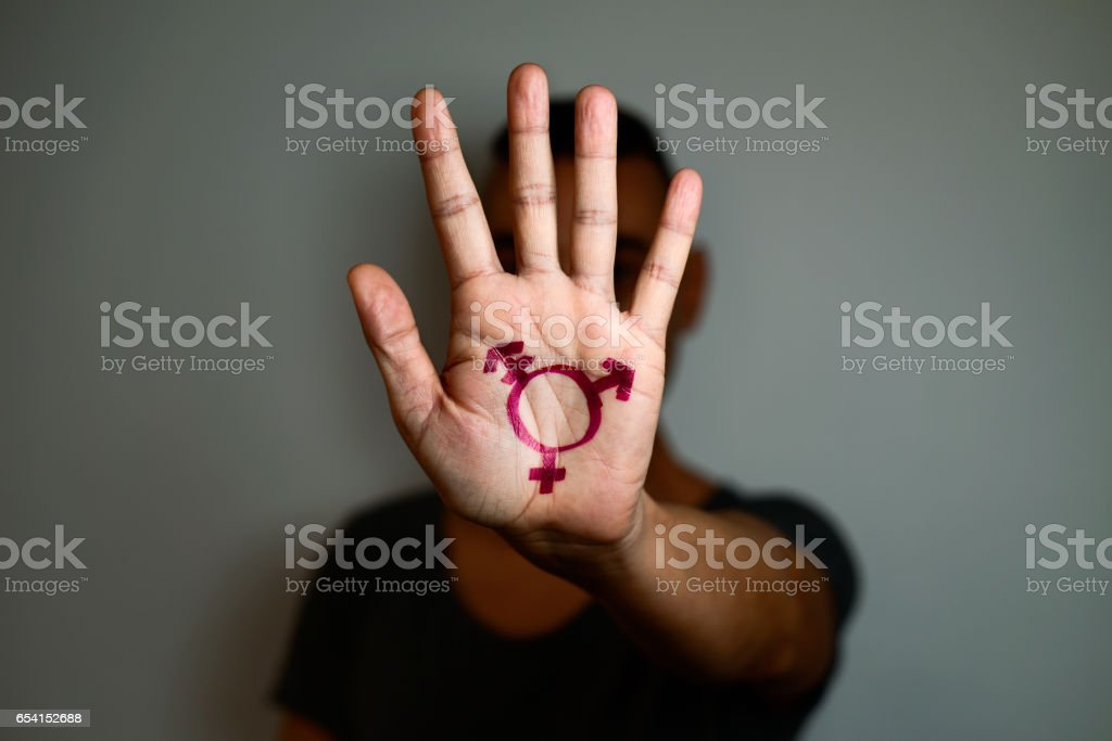 transgender symbol in the palm of the hand stock photo