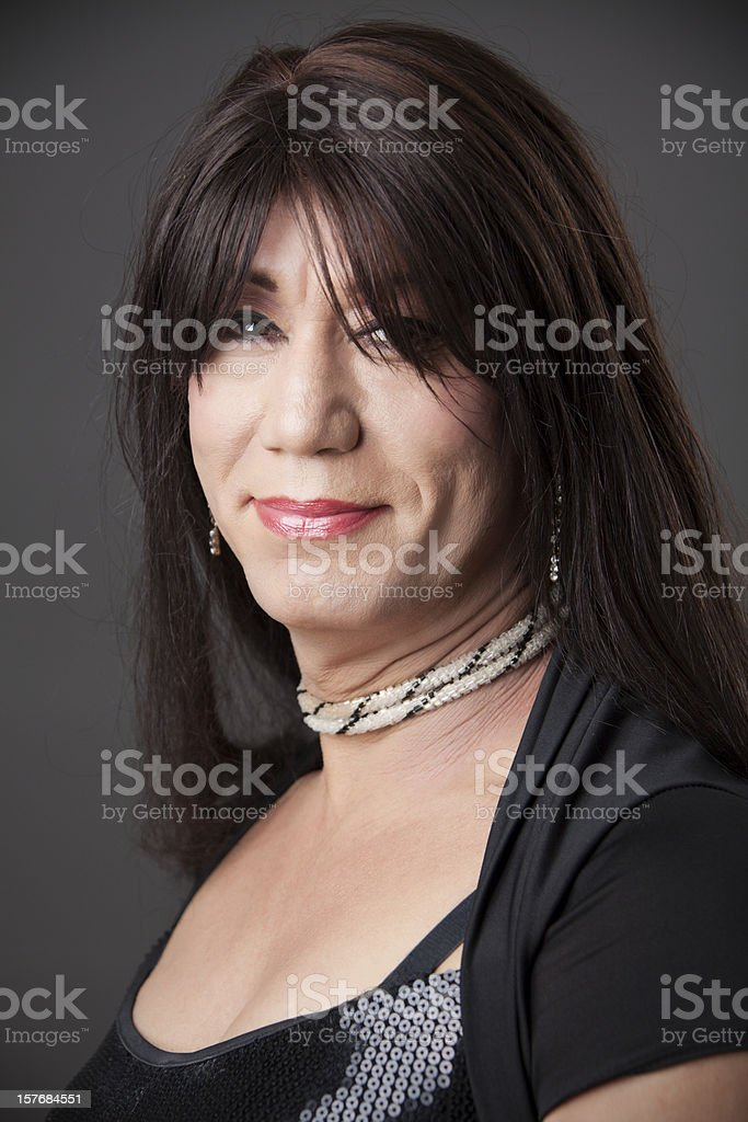 Studio portrait of sexy happy transgender man in his 50s stock photo