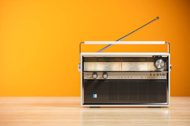 Transistor radio receiver on wood table in home interior 3d stock photo