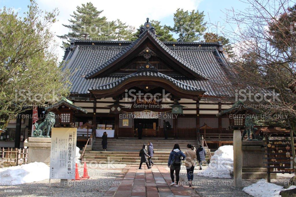 Translation: 'Oyama Shrine'. It was covered by light snow. stock photo