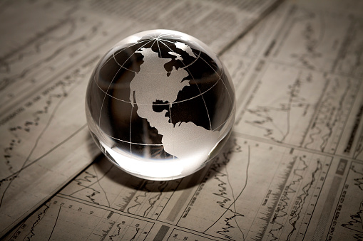 813402032 istock photo 3D translucent globe paperweight on funicular paperwork 160786629