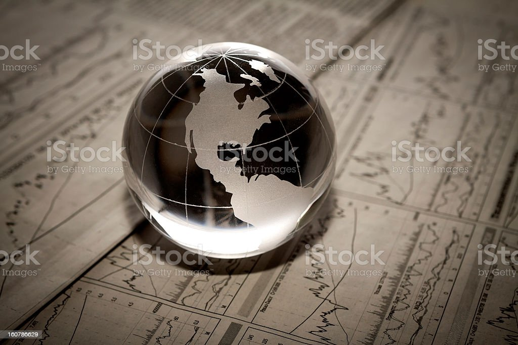 3D translucent globe paperweight on funicular paperwork stock photo