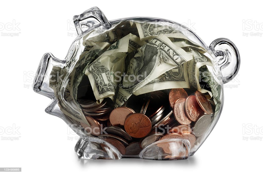 translucent piggy bank with money royalty-free stock photo