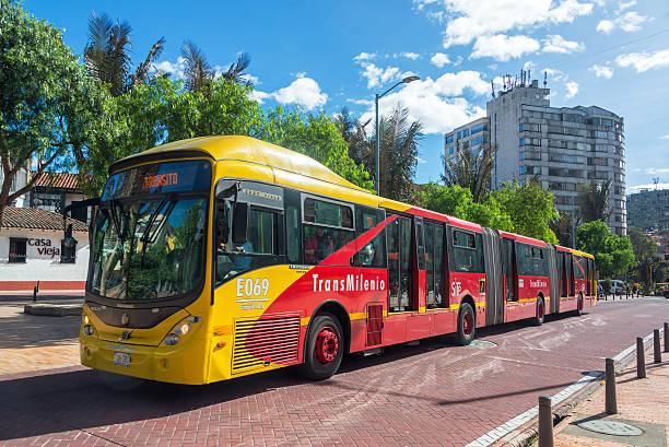 Transmilenio Bus in Bogota Bogota, Colombia - April 21, 2016: Transmilenio bus passes through downtown Bogota, Colombia on April 21, 2016 bus rapid transit stock pictures, royalty-free photos & images