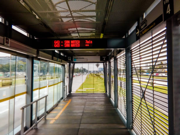 Transmilenio station with electronic information screen Transmilenio station with electronic information screen bus rapid transit stock pictures, royalty-free photos & images