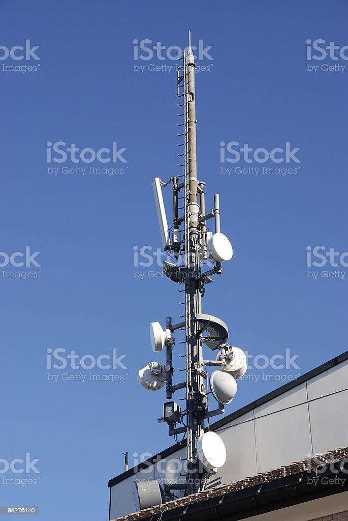 transmitting antenna against blue sky royalty-free stock photo