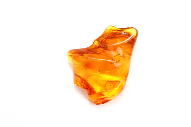 Transparent amber yellow with a wavy surface. - Photo