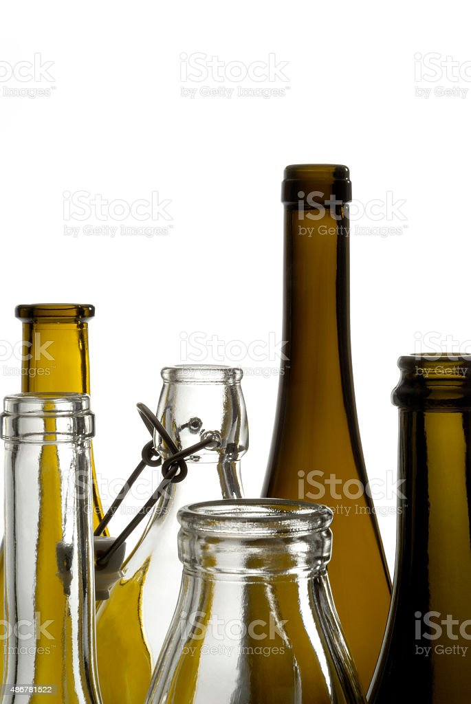 Transparent bottles of different varieties isolated on white stock photo